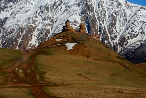 The famous view to the Trinity church of Gergeti at Stepantsminda